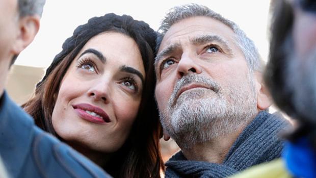 George Clooney y su mujer, Amal en Washington
